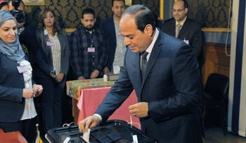 Egyptian President Abdel Fattah al-Sisi casting his vote on the first day of the 2018 presidential elections at a polling station in the capital Cairo on March 26, 2018/