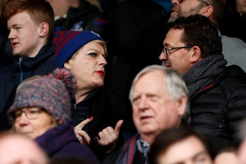 Eddie Izzard, left, attending a soccer game in England between Crystal Palace and Manchester City, December 2017.