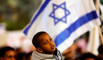 A boy takes part in a protest against the Israeli government's plan to deport African migrants, in Tel Aviv, Israel March 24, 2018