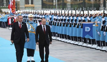 Turkish President Tayyip Erdogan and his Russian counterpart Vladimir Putin review a guard of honour during a welcoming ceremony at the Presidential Palace in Ankara on April 3, 2018