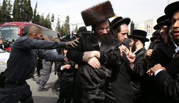 Ultra-Orthodox demonstrators protesting in Jerusalem over a decision to perform an autopsy on the body of a dead baby.