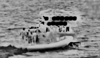 A screenshot from a video showing an Israel Navy boat intercepting the Palestinian boat.