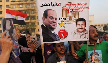 FILE PHOTO: Supporters of Egyptian President Abdel Fattah al-Sissi celebrate in Cairo's Tahrir square following his re-election for a second term, on April 2, 2018.