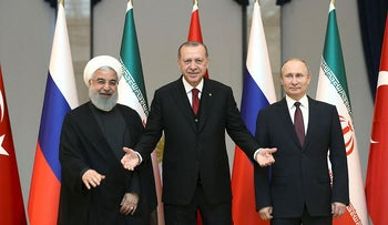 Turkish President Tayyip Erdogan poses with his counterparts Hassan Rouhani of Iran and Vladimir Putin of Russia before their meeting in Ankara, Turkey April 4, 2018