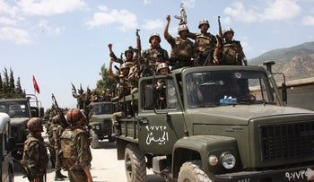 Syrian army soldiers chant slogans in support of Syrian President Bashar Assad