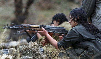 In this Friday, Dec. 18, 2009 file photo, a member of the Kurdistan Workers' Party, or PKK, trains on a weapon at their camp in the Qandil mountains near the Turkish border with northern Iraq