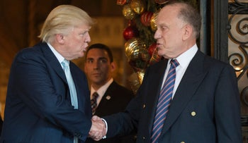 U.S. President Donald Trump shakes hands with Ronald Lauder, President of the World Jewish Congress, Mar-a-Lago, Florida, December 28, 2016.