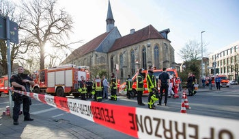Police and first responders at the scene where three people were killed and 20 injured when a van plowed into pedestrians in Muenster, Germany on April 7, 2018.