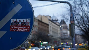 """A sticker with an image of Soros in the center saying """"they'd cut down the border fence if they could,"""" Budapest, Hungary"""