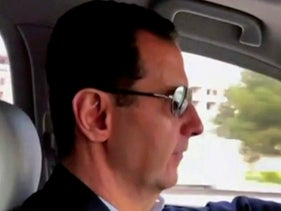Assad driving himself to the newly captured areas of eastern Ghouta, near the capital Damascus, Syria
