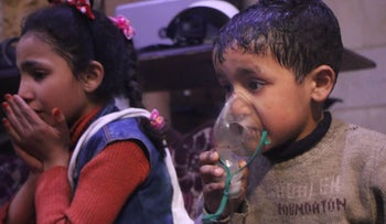 Children receive treatment after a chemical attack in Douma, Syria, April 7, 2018.