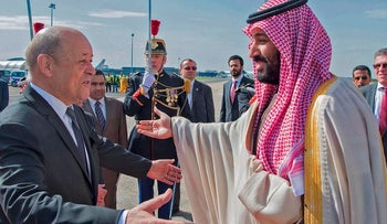 French Foreign Affairs Minister Jean-Yves Le Drian (L) welcomes Saudi Arabia's crown prince Prince Mohammed bin Salman (R) at Paris - Le Bourget airport, north of Paris, on April 8, 2018