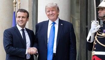 FILE PHOTO: French President Emmanuel Macron and U.S. President Donald Trump shake hands while posing for photographs in France, July 13, 2017.