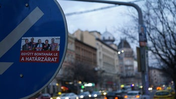 "An anti-immigration election sticker on a road sign in Budapest, April 7, 2018. It reads: ""They'd cut down the border fence together."""