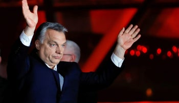 Hungarian Prime Minister Viktor Orban addresses supporters after the announcement of the partial results of parliamentary election in Budapest, Hungary, April 8