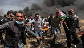 An injured Palestinian protestor is carried by fellow demonstrators during clashes with Israeli security forces east of Khan Yunis, southern Gaza Strip. April 6, 2018