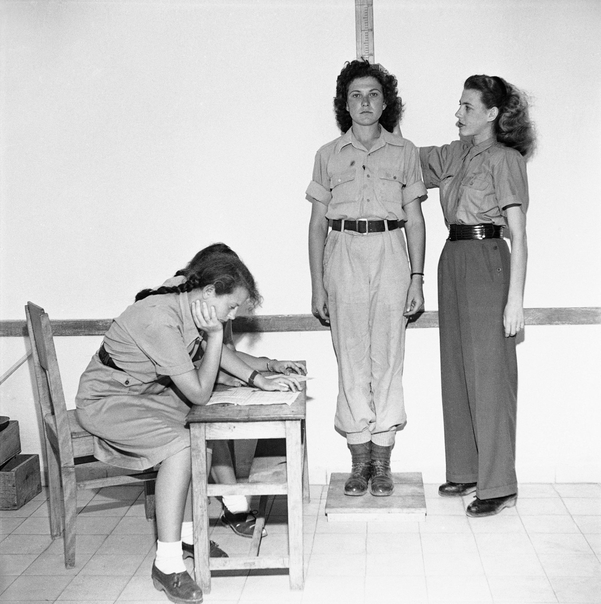 Members of the women's division of the Stern Gang are given physical examinations before induction into the Israeli army, June 1948.