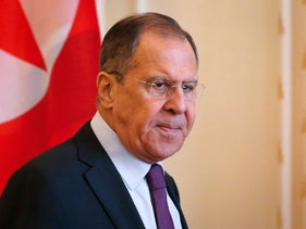 Russian Foreign Minister Sergey Lavrov enters a hall during his meeting with North Korean Foreign Minister Ri Yong Ho in Moscow, Russia, Tuesday, April 10, 2018