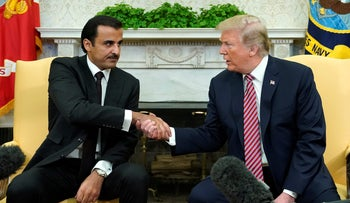 U.S. President Donald Trump meets Qatar's Emir Sheikh Tamim bin Hamad al-Thani in the Oval Office at the White House in Washington, U.S., April 10, 2018.