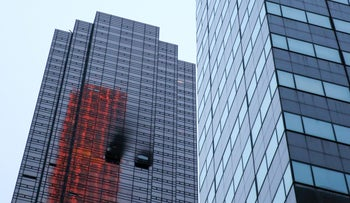 Damaged windows are seen after a fire broke out in an apartment in Trump Tower in New York, April 7, 2018.