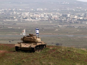 A military vehicle seen positioned on the Israeli side of the border with Syria.