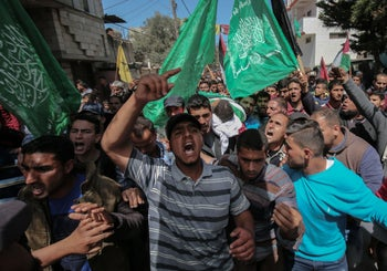 Palestinians at a funeral of Marwan Qudeih, who was wounded by Israeli fire, in Khan Yunis on April 9, 2018.