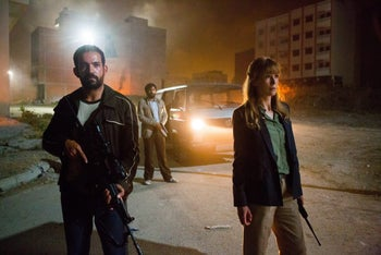 """A scene from """"Beirut,"""" with Rosamund Pike as CIA agent Sandy Crowder. The film's recreation of 1982 Beirut was overseen by Israeli production designer Arad Sawat."""