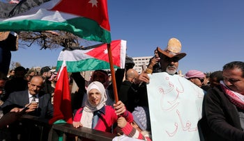 """Protesters are seen in front of parliament in Amman, Jordan February 1, 2018. The sign reads """"Don't raise prices"""""""