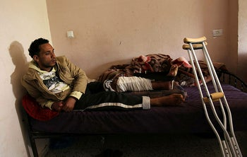 Tamer Abu Daqqa rests at his home in Khan Yunis in the southern Gaza Strip on April 11, 2018 following the shooting.