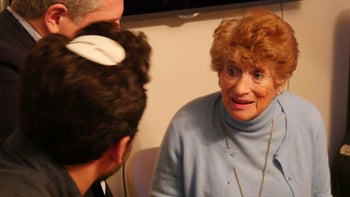 Holocaust survivor Rachel Roth talking to guests during a Memories in the Living Room event in the Upper West Side, New York, April 11, 2018.