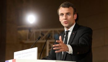 French President Emmanuel Macron delivers a speech during a meeting of the Bishops' Conference of France (CEF) at College des Bernardins in Paris, France, April 9, 2018