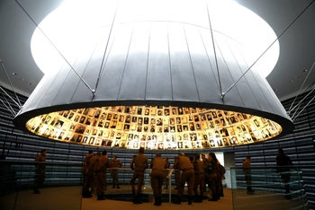 A group of Israeli soldiers visits the Hall of Names in the Holocaust History Museum at the Yad Vashem World Holocaust Remembrance Center in Jerusalem ahead of the Israeli annual Holocaust Remembrance Day, April 10, 2018.
