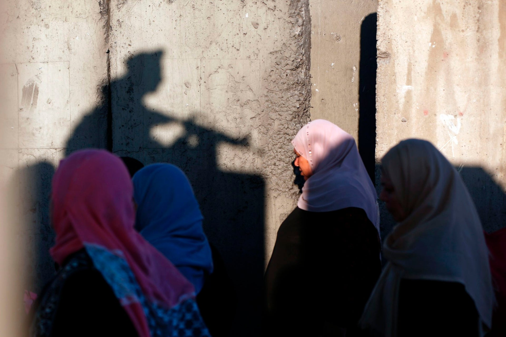 Palestinians wait to cross the Qalandiyah checkpoint between the West Bank city of Ramallah and Jerusalem.