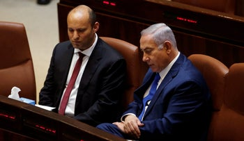 Israeli Prime Minister Benjamin Netanyahu sits next to Israeli Education Minister Naftali Bennett during a session of the plenum of the Knesset, in Jerusalem, March 12, 2018
