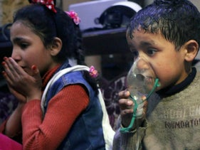 This image released by the White Helmets shows a child receiving oxygen following an alleged poison gas attack in the rebel-held town of Douma, near Damascus, Syria, April 8, 2018.