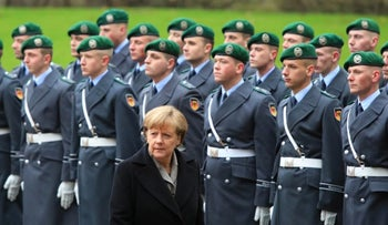 Chancellor Angela Merkel passing in front of German soldiers, 2017.