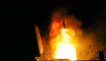 In this image released by the US Department of Defense the guided-missile cruiser USS Monterey fires a Tomahawk land attack missile on April 14, 2018.
