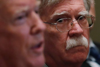 U.S. President Donald Trump receives a briefing from senior military leadership accompanied by his new National Security Adviser John Bolton in Washington, DC