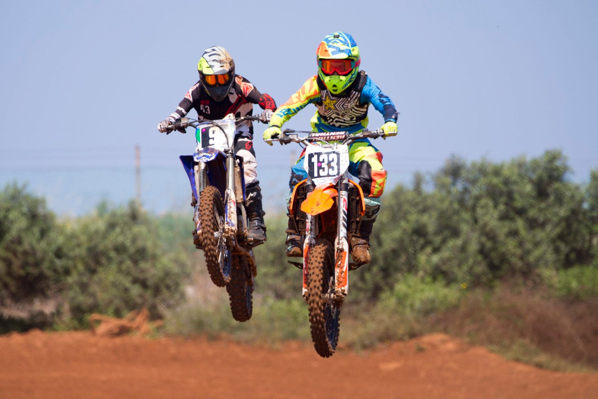 Riders compete during Israel's motocross championship in the MX Wingate cross country race track near in Netanya, Israel, Saturday, April 14, 2018.