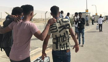 Asylum seekers pose for a photograph at Saharonim detention facility in the Negev desert, Israel, March 8, 2018.