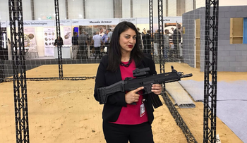 """Aviva Zimmerman taking a break from filming an episode of """"Avi Does the Holy Land"""" at a defense and security expo in Tel Aviv, June 2017."""