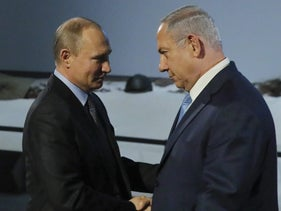 Russian President Putin and Prime Minister Netanyahu shake hands at an event marking International Holocaust Remembrance Day in Moscow in January, 2018.
