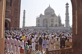 Indian Muslims offer prayers at a mosque in the premises of the Taj Mahal in Agra, India, Monday, June 26, 2017. Millions of Muslims across the world are celebrating the Eid al-Fitr holiday,