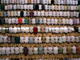 FILE -In this Friday, July 1, 2016, file photo, Muslims offer prayers on the last Friday of the holy month of Ramadan in Allhabad, India. Muslims throughout the world are marking the month of Ramadan, the holiest month on the Islamic calendar, by fasting from dawn till dusk. (AP Photo/ Rajesh Kumar Singh, File)