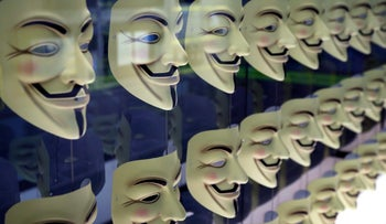 In this Monday, Feb. 12, 2018 photo, Guy Fawkes masks, often associated with the hacker group Anonymous, are displayed in a section about hacking at SPYSCAPE in New York.