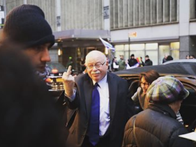 Instagram post showing Michael Steinhardt flashing his middle finger at protesters outside a gala dinner