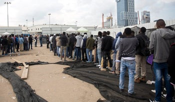 Asylum seekers wait outside the Immigration Authority office in Bnei Brak, April 11, 2018.