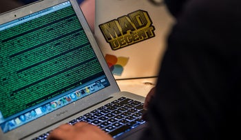 A developer works on code during the Facebook F8 Developers Conference in San Francisco, California, April 30, 2014.