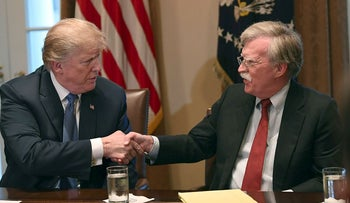 President Donald Trump, left, shakes hands with national security adviser John Bolton in the Cabinet Room of the White House in Washington, Monday, April 9, 2018, at the start of a meeting