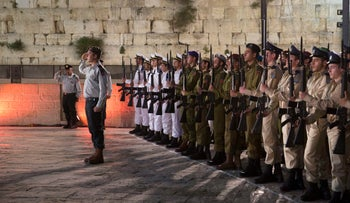 Israeli soldiers stand in formation during a ceremony to mark the annual Memorial Day for Israel's fallen soldiers at the Western Wall, Tuesday, April 17, 2018